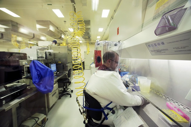 A lab technician works in the Level 4 lab at the National Microbiology Lab in Winnipeg