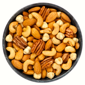 Mixed nuts in a bowl on white background