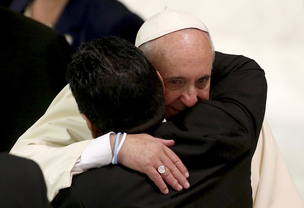 "Former soccer star Maradona hugs Pope Francis during a special audience held before a special interreligious ""Match for Peace"","