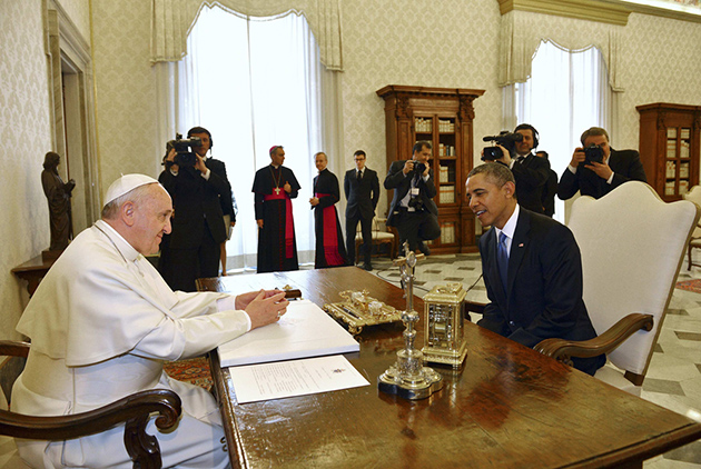 U.S. President Barack Obama talks with Pope Francis during a private audience at the Vatican City