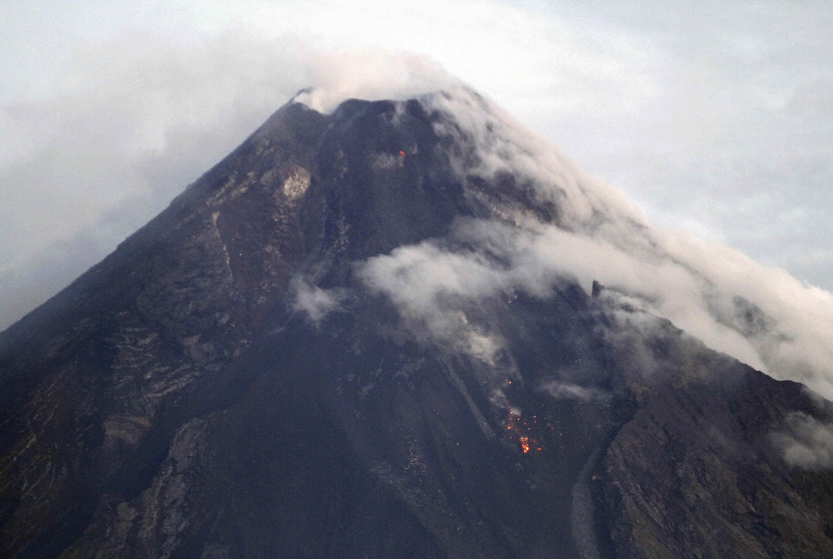 Mayon Volcano is seen emitting smoke in Albay province, Bicol region, south of Manila