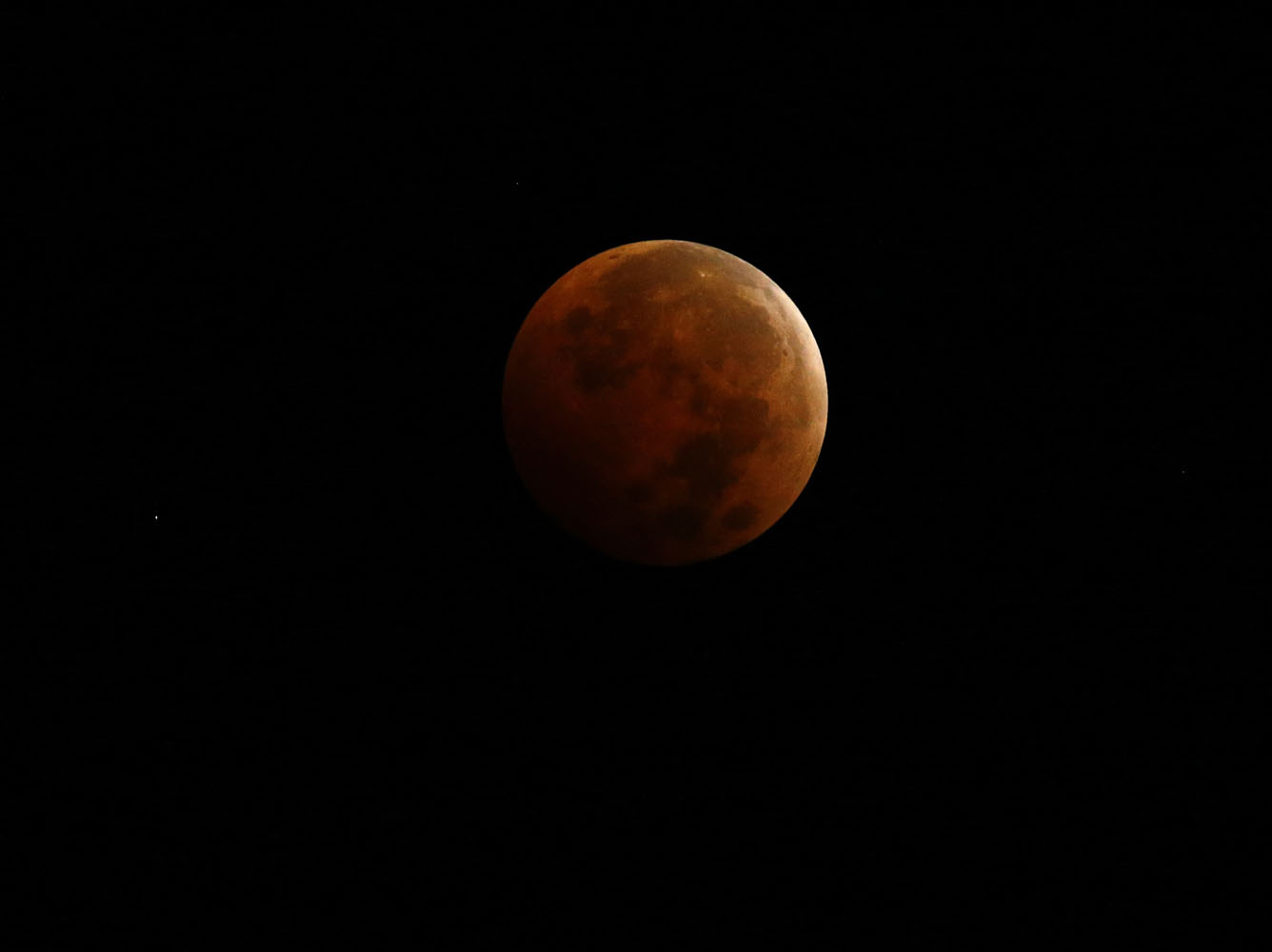 """A total lunar eclipse, also known as a """"blood moon"""", is pictured from Encinitas, California"""