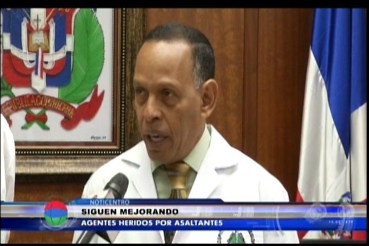 Siguen Mejorando Agentes Heridos En Asalto Banco Popular